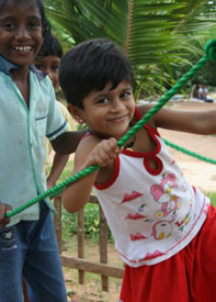 Image of a girl playing on a robe bridge in a CCF Child Centered Space