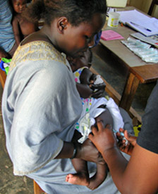 Image of an infant receiving an immunization as part of CCF-Uganda's early childhood care and development program