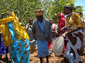 Image of parents from Mt. Kenya celebrating with song and dance