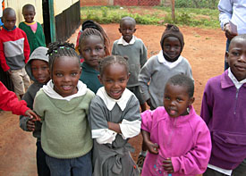 Image of children in Nairobi congregating outside a CCF early childhood development center