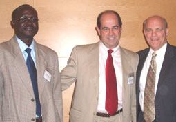 Image of James Pimundu, David Shanklin and Admiral Tim Ziemer at the NGO Panel Discussion