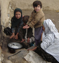 Image of a family in Afghanistan warming their hands