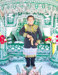 Image of an Indonesian man in traditional wedding attire
