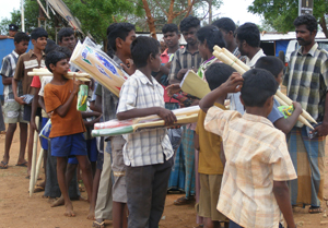 Image of boys collecting distribution items in post-conflict Sri Lanka