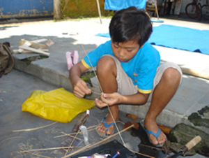 Image of a child making a kite for The Power to Play