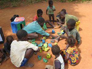 Children in Africa playing with their handmade toys