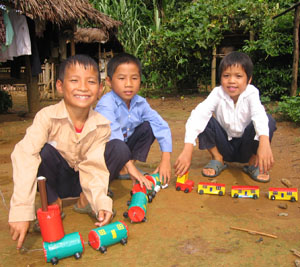 Boys play with homemade toy train
