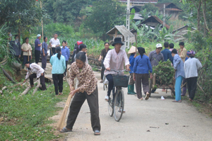 Community members cleaning road
