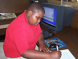 Child using internet at the library