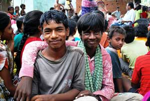 Photo of two youth in India, smiling.