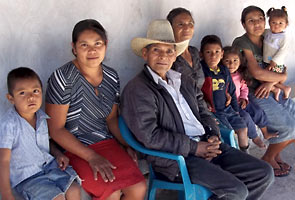 Midwife Dominga with husband, children and grandchildren, including daughter Lesly and granddaughter Estefany.