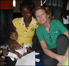 Anne Lynam Goddard with a teenage mother and her baby at an ANDP center.