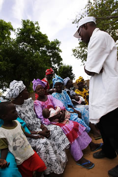 Image of Families attending a malaria clinic in Senegal.
