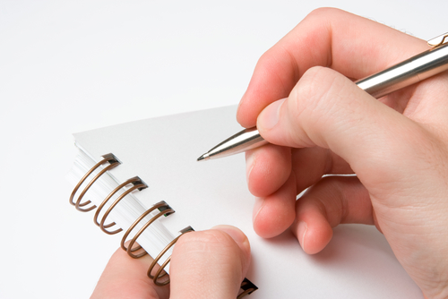 Image of hand and pen
