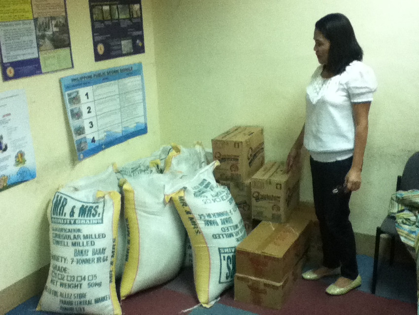 Image of woman with bags of rice.