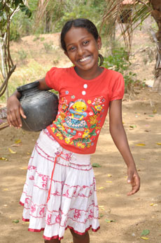 A young girl fetches water.