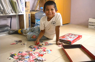 Javier Celestino, 8, loves putting this puzzle together piece by piece.
