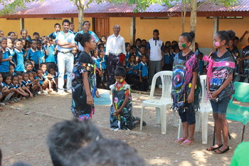 Children Against Violence present their anti-corporal punishment skit to around 500 classmates and 10 teachers.