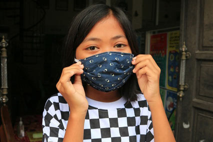 Girl wearing facemask in Indonesia.