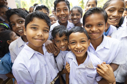 Group of kids in school uniforms standing outside in India