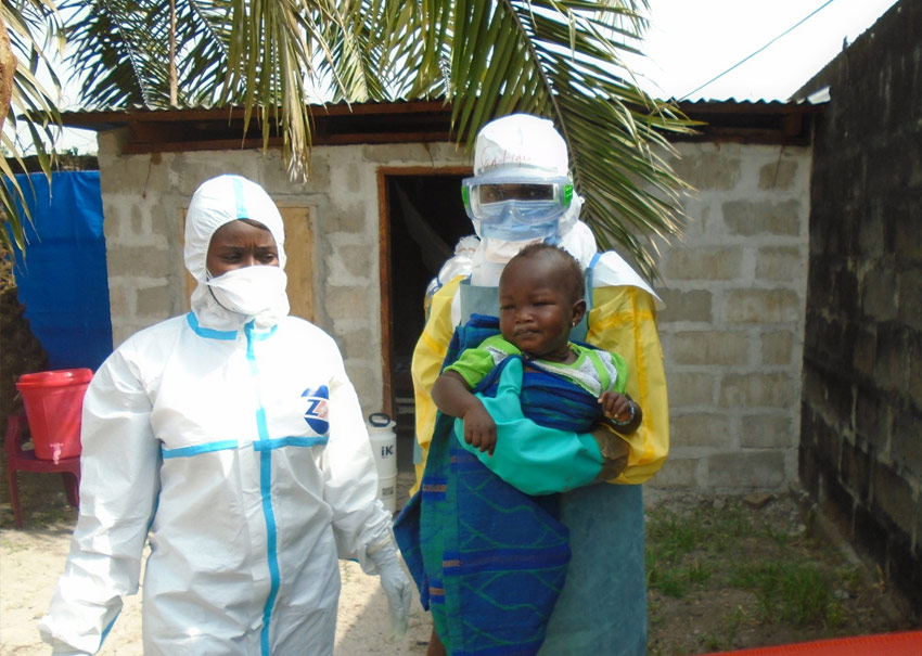 Community health workers care for a baby at one of ChildFund's interim care centers during the 2015 Ebola outbreak in Sierra Leone.
