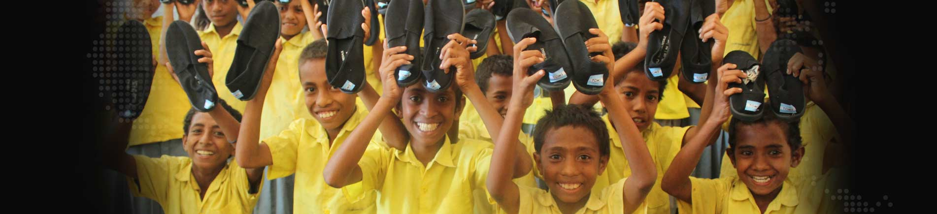Smiling children with shoes