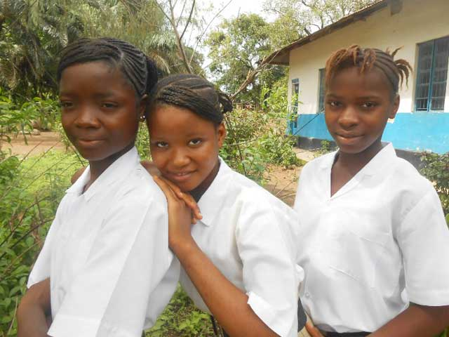 Three kids in Sierra Leone