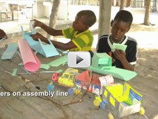 Screenshot of video depicting boys building toy trucks