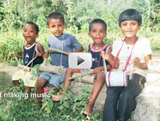 Screenshot of video depicting children playing handmade musical instruments