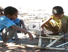 Screenshot of video depicting boys building a rideable scooter