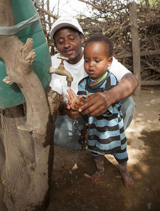 A teacher and child at an ECD center in Zambia.