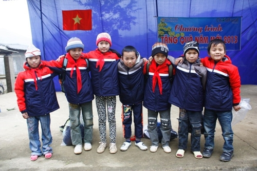 A group of Vietnamese children proudly wear their new winter jackets provided through our Gifts of Love & Hope catalog.