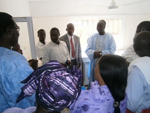 The Gambian minister of health is briefed at a clinic.